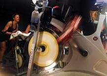 The wheels of an indoor bicycle are seen spinning at a SoulCycle class at their Union Square location in New York April 13, 2011. RREUTERS/Shannon Stapleton