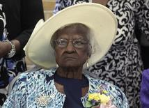 Jeralean Talley sits at the head table during a celebration of her 115th birthday at the New Jerusalem Missionary Baptist Church in Inkster,  Michigan May 25, 2014.  REUTERS/Rebecca Cook