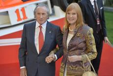Former Formula One driver Jackie Stewart and his wife Helen arrive at the world premiere of Rush at a cinema in Leicester Square, central London, September 2, 2013. REUTERS/Toby Melville