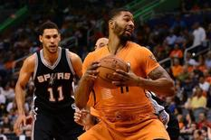 Oct 31, 2014; Phoenix, AZ, USA; Phoenix Suns forward Markieff Morris (11) handles the ball against the San Antonio Spurs in the first half at US Airways Center. The Suns won 94 - 89.  Jennifer Stewart-USA TODAY Sports