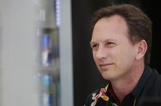 Red Bull Formula One team principal Christian Horner looks on at the team paddock before the first practice session of the Bahrain F1 Grand Prix at the Bahrain International Circuit (BIC) in Sakhir, south of Manama April 4, 2014. REUTERS/Caren Firouz