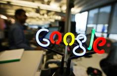 A neon Google logo is seen as employees work at the new Google office in Toronto, in this file photo from November 13, 2012.  REUTERS/Mark Blinch/Files