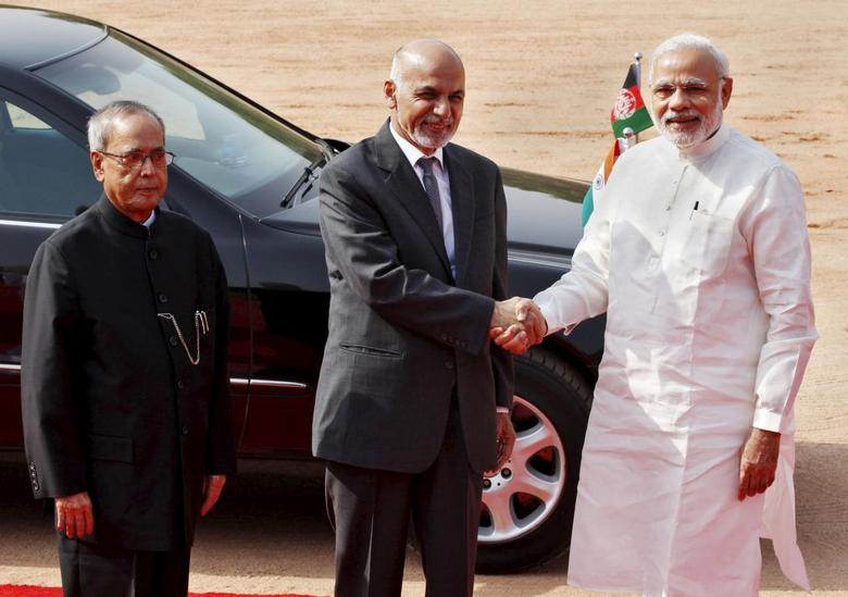 Afghanistan's President Ashraf Ghani (C) shakes hands with India's Prime Minister Narendra Modi (R) as his Indian counterpart Pranab Mukherjee looks on upon Ghani's arrival to attend a ceremonial reception at the forecourt of India's presidential palace Rashtrapati Bhavan, in New Delhi, India, April 28, 2015.  REUTERS/Stringer