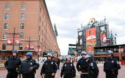 Baltimore police officers stand outside the stadium prior to the cancellation of the game between the Chicago White Sox and Baltimore Orioles at Oriole Park at Camden Yards, April 27, 2015. Mandatory Credit: Evan Habeeb-USA TODAY Sports