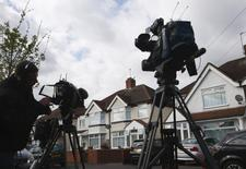 Television crews wait outside the address where Nav Sarao Futures Limited is registered, in Hounslow, west London April 22, 2015. REUTERS/Eddie Keogh