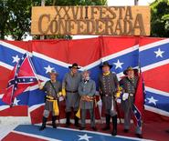 Descendants of American Southerners wearing Confederate-era uniforms pose for a photograph during a party to celebrate the 150th anniversary of the end of the American Civil War in Santa Barbara D'Oeste, Brazil, April 26, 2015.  REUTERS/Paulo Whitaker