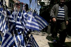 Greek national flags are on display at a shop in central Athens April 17, 2015. REUTERS/Alkis Konstantinidis