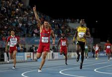 Ryan Bailey of the U.S. (C) celebrates as he crosses the finish line ahead of Jamaica's Usain Bolt (L) as the U.S. won the 4x100 meters race at the IAAF World Relays Championships in Nassau, Bahamas, May 2, 2015. Japan's Kataro Taniguchi is at left. REUTERS/Mike Segar