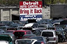 A large 'Buy American' sign, in support of Detroit's auto industry, is seen in the back of an auto scrap yard in Detroit, Michigan May 18, 2009.