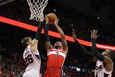 May 3, 2015; Atlanta, GA, USA; Washington Wizards guard Bradley Beal (3) shoots over Atlanta Hawks guard Kyle Korver (26) and forward Paul Millsap (4) in the second quarter in game one of the second round of the NBA Playoffs. at Philips Arena. Mandatory Credit: Brett Davis-USA TODAY