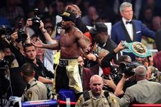 May 2, 2015; Las Vegas, NV, USA; Floyd Mayweather celebrates after defeating Manny Pacquiao (not pictured) via unanimous decision during their world welterweight championship bout at MGM Grand Garden Arena. Mandatory Credit: Joe Camporeale-USA TODAY Sports