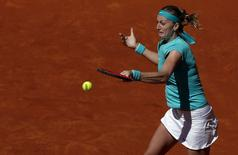Czech Republic's Petra Kvitova returns the ball to Coco Vandeweghe of the U.S. during their match at the Madrid Open tennis tournament in Madrid, Spain, May 5, 2015. REUTERS/Juan Medina