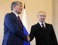 "Russian President Vladimir Putin (R) and his Kyrgyz counterpart Almazbek Atambayev shake hands during their meeting at the Constantine (Konstantinovsky) Palace in St. Petersburg March 16, 2015.  Putin laughed off suggestions he had been forced to lie low because of poor health, saying on Monday that life would be ""boring without gossip"".  REUTERS/Anatoly Maltsev/Pool (RUSSIA - Tags: POLITICS)"