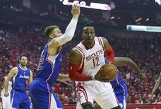 May 6, 2015; Houston, TX, USA; Houston Rockets center Dwight Howard (12) attempts to take the ball to the basket during the first quarter as Los Angeles Clippers forward Blake Griffin (32) defends in game two of the second round of the NBA Playoffs at Toyota Center. Mandatory Credit: Troy Taormina-USA TODAY Sports