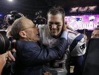 New England Patriots quarterback Tom Brady is congratulated by team president Jonathan Kraft after defeating the Seattle Seahawks in the NFL Super Bowl XLIX football game in Glendale, Arizona February 1, 2015.  REUTERS/Brian Snyder