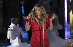 Singer Mariah Carey performs at the lighting ceremony for the 82nd Rockefeller Center Christmas tree at Rockefeller Center in midtown Manhattan in New York City, December 3, 2014. REUTERS/Mike Segar