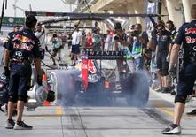 Red Bull Formula One Driver Daniel Ricciardo of Australia drives out of the pit-lane during the third free practice ahead of Bahrain's F1 Grand Prix at Bahrain International Circuit, south of Manama April 18, 2015. REUTERS/Ahmed Jadallah