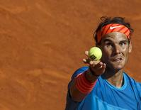 Spain's Rafael Nadal serves to Czech Republic's Tomas Berdych during their semi-final match at the Madrid Open tennis tournament in Madrid, Spain, May 9, 2015. REUTERS/Sergio Perez