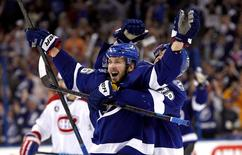 Tampa Bay Lightning right wing Nikita Kucherov (86) and left wing Ondrej Palat (18) celebrate their 4-1 win over the Montreal Canadiens in game six of the second round of the 2015 Stanley Cup Playoffs at Amalie Arena. Mandatory Credit: Reinhold Matay-USA TODAY Sports