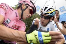 Tinkoff Saxo rider Alberto Contador of Spain (L) talks with Astana Pro team rider Fabio Aru of Italy before the start of the 183 km ( 113 miles) sixth stage of the 98th Giro d'Italia ( Tour of Italy ) cycling race from Montecatini Terme to Castiglione della Pescaia , Italy, May 14, 2015. . REUTERS/LaPresse/Fabio Ferrari