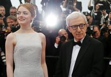 "Director Woody Allen (R) and cast member Emma Stone (L) pose on the red carpet as they arrive for the screening of the film ""Irrational Man"". REUTERS/Regis Duvignau"