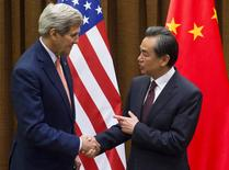 Chinese Foreign Minister Wang Yi and U.S. Secretary of State John Kerry (L) shake hands prior to meetings at the Ministry of Foreign Affairs in Beijing on May 16, 2015. REUTERS/Saul Loeb/Pool