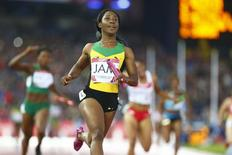 Jamaica's Shelly-Ann Fraser-Pryce runs the anchor leg as Jamaica wins the women's 4x100m relay final at the 2014 Commonwealth Games in Glasgow, Scotland, August 2, 2014. REUTERS/Andrew Winning