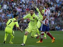 Barcelona's Lionel Messi (C) celebrates his goal against Atletico Madrid during their Spanish first division soccer match at Vicente Calderon stadium in Madrid, Spain, May 17, 2015. REUTERS/Andrea Comas