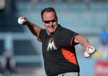 May 11, 2015; Los Angeles, CA, USA; Miami Marlins manager Mike Redmond throws during batting practice before the game against the Los Angeles Dodgers at Dodger Stadium. Mandatory Credit: Kirby Lee-USA TODAY Sports