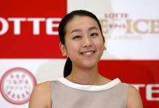 Japanese figure skater Mao Asada smiles during a news conference in Tokyo May 18, 2015.  REUTERS/Issei Kato