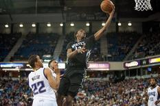 Minnesota Timberwolves forward Andrew Wiggins (22) goes up for the shot against Sacramento Kings guard Andre Miller (22) during the fourth quarter at Sleep Train Arena. Apr 7, 2015; Sacramento, CA, USA; Ed Szczepanski-USA TODAY Sports