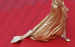 "The dress and the shoes of an unidentified guest are pictured as she walks on the red carpet during arrivals for the screening of the film ""Sicario"" in competition at the 68th Cannes Film Festival in Cannes, southern France, May 19, 2015.  REUTERS/Regis Duvignau"