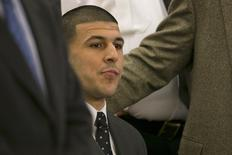 Former NFL player Aaron Hernandez listens as the guilty verdict is read during his murder trial at the Bristol County Superior Court in Fall River, Massachusetts, April 15, 2015.  REUTERS/Dominick Reuter