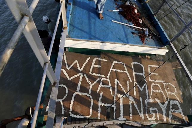Plywood with the words ''We are Myanmar Rohingya'' is seen in an abandoned boat which carried Rohingya and Bangladeshi migrants from Thailand, found off the coast near the city of Kuta Binje, Indonesia's Aceh Province May 20, 2015. REUTERS/Beawiharta