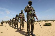 Members of Somalia's Al Shabaab militant group parade during a demonstration to announce their integration with al Qaeda, in Elasha, south of the capital Mogadishu in a file photo.  REUTERS/Feisal Omar