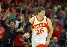 Atlanta Hawks guard Kyle Korver (26) reacts after making a basket against the Cleveland Cavaliers during the first quarter in game two of the Eastern Conference Finals of the NBA Playoffs at Philips Arena. Mandatory Credit: Brett Davis-USA TODAY Sports
