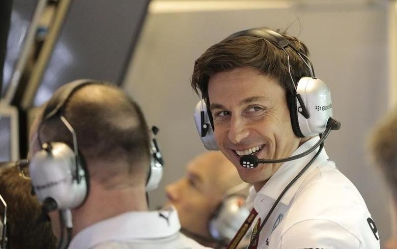 Mercedes motorsport head Toto Wolff smiles in the garage during the second practice session of the Abu Dhabi F1 Grand Prix at the Yas Marina circuit in Abu Dhabi November 21, 2014. REUTERS/Caren Firouz