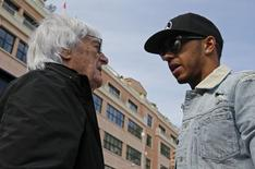 Mercedes Formula One driver Lewis Hamilton of Britain (R) talks with Formula One supremo Bernie Ecclestone as he arrives in the paddock ahead the start of the third free practice session at the Monaco F1 Grand Prix May 23, 2015. REUTERS/Max Rossi