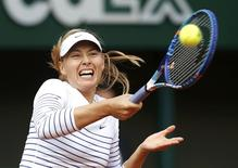 Maria Sharapova of Russia plays a shot to Kaia Kanepi of Estonia during their women's singles match at the French Open tennis tournament at the Roland Garros stadium in Paris, France, May 25, 2015.       REUTERS/Jean-Paul Pelissier