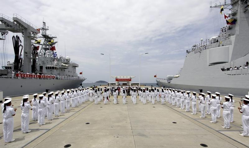 China to extend military reach, build lighthouses in disputed waters