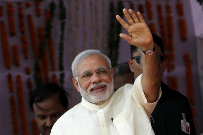 India's Modi urges farmers to boost output, skirts issue of rural distress