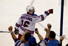 New York Rangers center Derick Brassard (16) celebrates his goal during the third period in game six of the Eastern Conference Final of the 2015 Stanley Cup Playoffs at Amalie Arena. Mandatory Credit: Reinhold Matay-USA TODAY Sports