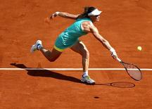 Samantha Stosur of Australia plays a shot to Amandine Hesse of France during their women's singles match at the French Open tennis tournament at the Roland Garros stadium in Paris, France, May 27, 2015.  REUTERS/Vincent Kessler
