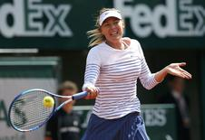 Maria Sharapova of Russia plays a shot to compatriot Vitalia Diatchenko during their women's singles match at the French Open tennis tournament at the Roland Garros stadium in Paris, France, May 27, 2015.     REUTERS/Gonzalo Fuentes