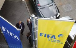 FIFA flags are pictured outside the Marritot hotel, where a meeting of the Confederation of African Football (CAF) is taking place, in Zurich, Switzerland, May 27, 2015. REUTERS/Arnd Wiegmann