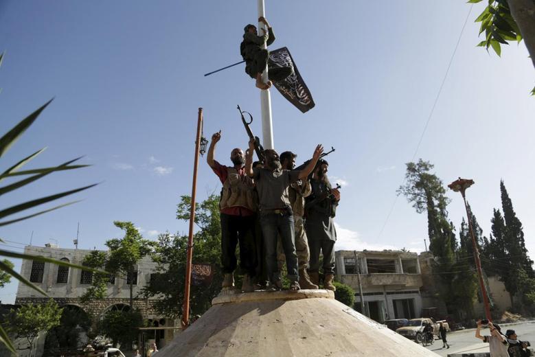 Insurgents advance in areas around captured Syrian...
