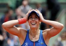 Alize Cornet of France celebrates after beating Mirjana Lucic-Baroni of Croatia during their  women's singles match at the French Open tennis tournament at the Roland Garros stadium in Paris, France, May 29, 2015.                REUTERS/Jean-Paul Pelissier