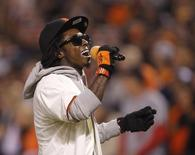 """Rapper Lil Wayne sings """"Take Me Out To The Ball Game"""".   REUTERS/Robert Galbraith"""