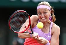 Petra Kvitova of the Czech Republic plays a shot to Irina-Camelia Begu of Romania during their women's singles match at the French Open tennis tournament at the Roland Garros stadium in Paris, France, May 30, 2015.    REUTERS/Pascal Rossignol