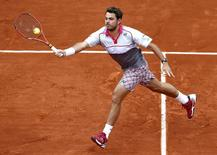 Stan Wawrinka of Switzerland plays a shot to Gilles Simon of France during their men's singles match at the French Open tennis tournament at the Roland Garros stadium in Paris, France, May 31, 2015.  REUTERS/Jean-Paul Pelissier